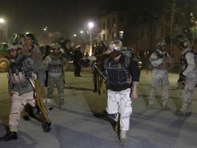 Members of the Afghan Crisis Response Unit (CRU) arrive at the site of a Taliban attack in Kabul, Afghanistan. A loud explosion rocked Kabul on Friday in a heavily protected area close to many foreign embassies and government buildings, with initial reports suggesting at least three attackers had targeted a guesthouse close to the Spanish embassy.