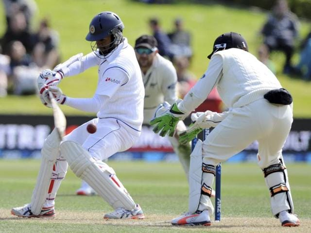 Dimuth Karunaratne of Sri Lanka plays a shot during day two of the first International Test cricket match between New Zealand and Sri Lanka at University Oval in Dunedin on December 11, 2015.