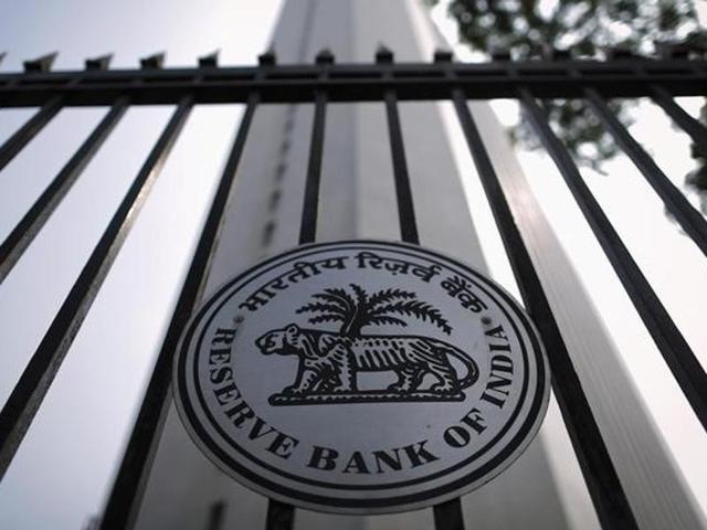 The Reserve Bank of India (RBI) seal is pictured on a gate outside the RBI headquarters in Mumbai.