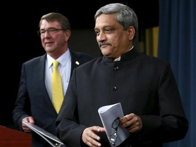 U.S. Defense Secretary Ash Carter and India's Defense Minister Manohar Parrikar arrive at a joint press conference after their meeting at the Pentagon in Washington on December 10, 2015.