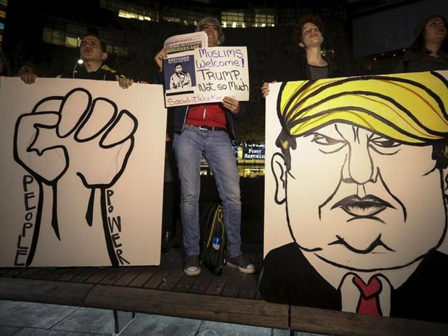 People take part in an anti-Donald Trump, pro-immigration protest in the Manhattan borough of New York December 10, 2015