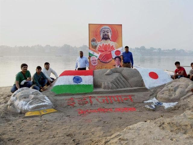Members of Indo-Japan Friendship Club and sand artists of BHU Fine Arts make portraits of PM Narendra Modi and Japanese PM Shinzo Abe in front of Assi Ghat in Varanasi.