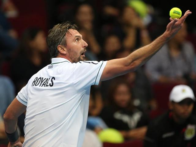 Obi UAE Royals Goran Ivanisevic serves the ball against the Micromax Indian Aces Fabrice Santoro of France during their match in the International Premier Tennis League on December 7, 2015.