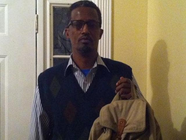 Abdirizak Aden holds his daughter's bookbag. A teacher asked his 13-year-old daughter if it contained a bomb.
