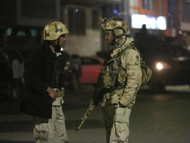 Members of the Afghan Crisis Response Unit (CRU) arrive at the site of a Taliban attack in the Afghan capital of Kabul. The siege ended on Saturday after the CRU killed all of the attackers.