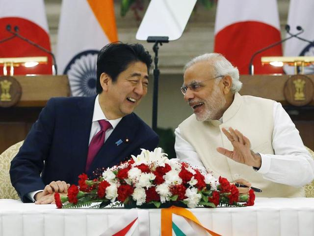 """Japanese PM Shinzo Abe and his Indian counterpart Narendra Modi share a moment while signing the agreement at Hyderabad House in New Delhion Saturday. According to a senior Indian official, """"having the Japanese on your side, makes nuclear arrangements with other countries much easier.""""(Reuters)"""