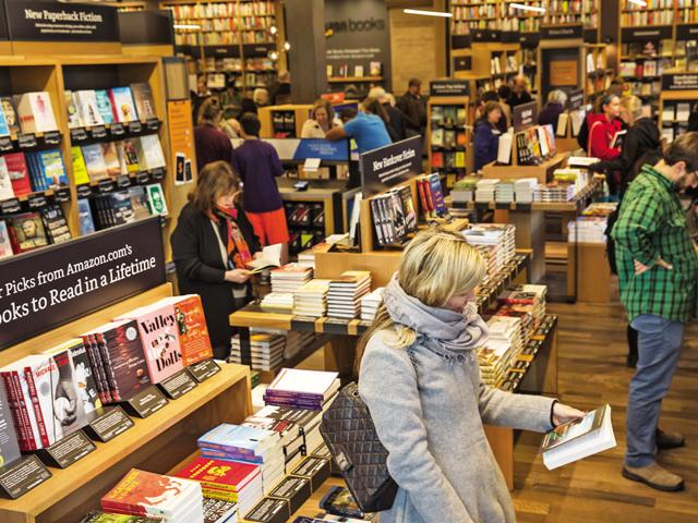 The old-fashioned way: Amazon opened its first physical bookstore in November this year in Seattle.  (Photo by Stephen Brashear/Getty Images)