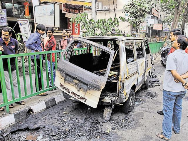 The charred ambulance in Thane on Friday.