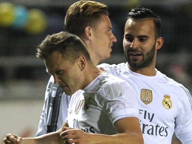 Real Madrid midfielder Denis Cheryshev celebrates after scoring during the Spanish Copa del Rey football match against  Cadiz CF on December 2, 2015.