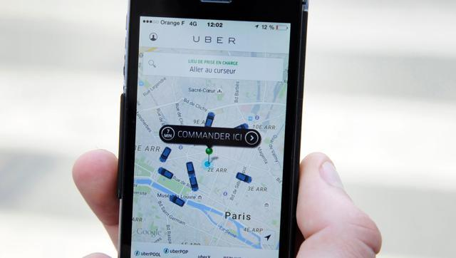 The Uber smartphone app, used to book taxis using its service, is pictured over a parking lot. (AFP photo)