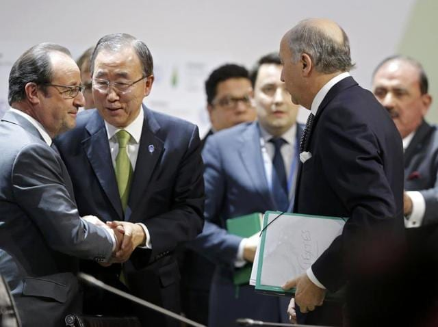 French President Francois Hollande (L), foreign minister Laurent Fabius (C) and United Nations Secretary General Ban Ki-moon arrive for a statement at the COP21 Climate Conference in Le Bourget.