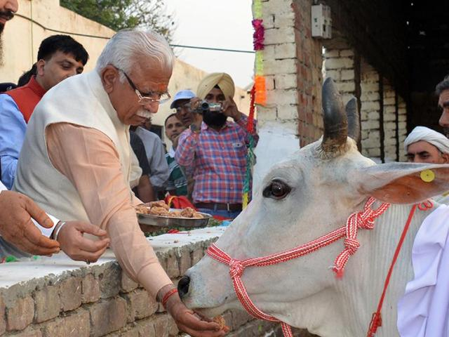 Haryana chief minister Manohar Lal Khattar had recently assured 'gau rakshaks' of revoking cases registered against them in the state; (right) logo of a cow-protection group.
