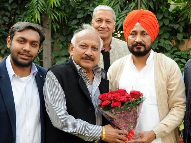 MLA Braham Mohindra congratulates newly appointed CLP leader Charanjit Channi in Patiala on Saturday.