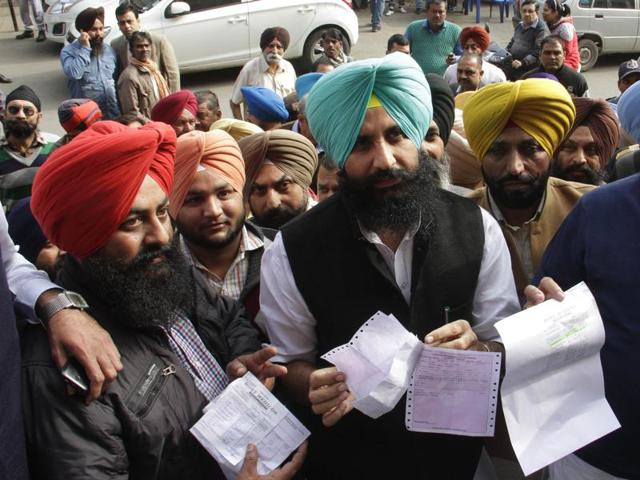 MLA Simarjit Singh Bains and his supporters outside CMC hospital, Ludhiana on Saturday.