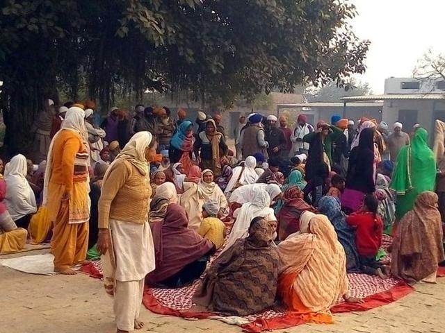 Locals holding a protest at Gurdwara Rathike Sahib near Patti in Tarn Taran district on Friday.