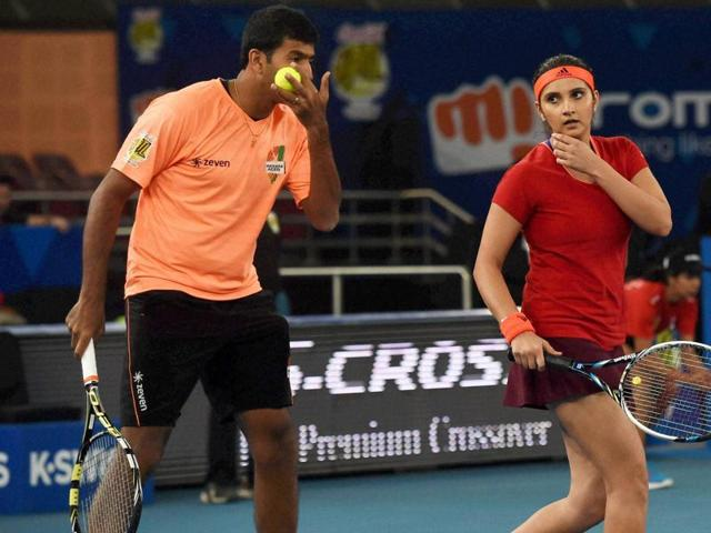 Sania Mirza and Rohan Bopanna of Micromax Indian Aces in action during the International Premier Tennis League (IPTL) match at the IG Stadium in New Delhi on December 11, 2015.