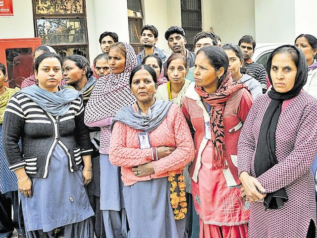 Class VI employees waiting for health minister Surjeet Kumar Jayani at civil hospital in Jalandhar on Saturday.