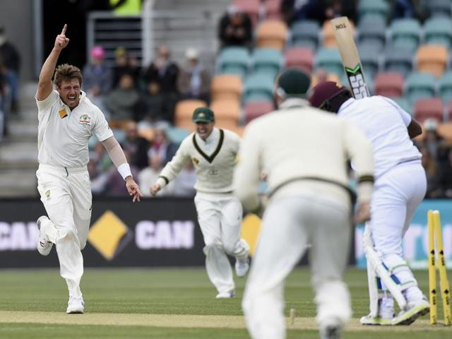Australia's James Pattinson celebrates with teammates after dismissing West Indies' Jermaine Blackwood during their cricket test match in Hobart on December 12, 2015.