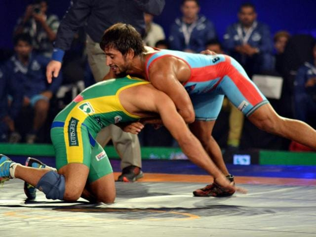 Bajrang Punia from Bengaluru Yodhas fights Rahul Mann from UP during the Pro wrestling league 2015 in New Delhi on December 11, 2015.