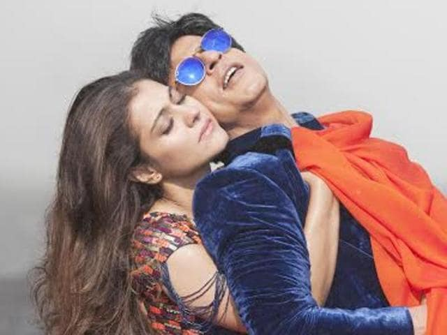 Shah Rukh Khan, left and Kajol pose for photographers during the photo call for the film Dilwale in a central London hotel, Tuesday, Dec. 1, 2015.