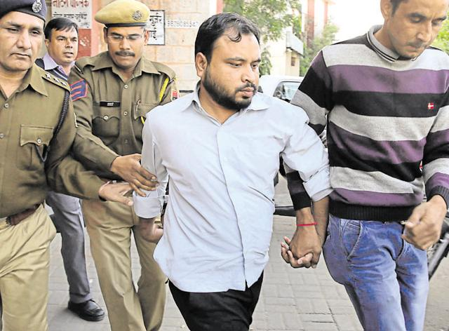 Policemen escort alleged Islamic State sympathiser Mohammed Sirajuddin (centre) after being produced in a court in Jaipur on Friday.