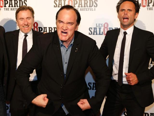 US director Quentin Tarantino (C) poses with Tim Roth and Walton Goggins during a photocall for the premiere of his latest movie, The Hateful Eight.