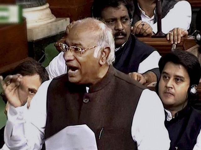 Congress leader Mallikarjun Kharge speaks in the Lok Sabha during the ongoing Winter Session of Parliament in New Delhi .