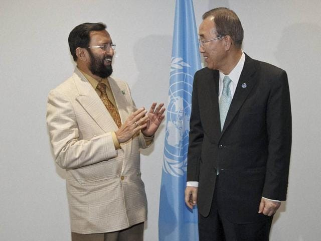 Environment minister Prakash Javadekar speaks with United Nations Secretary General Ban Ki-moon prior to a bilateral meeting at the COP21 United Nations Climate Change Conference in Le Bourget near Paris on Friday. javadekar said the climate change agreement adopted at the COP21 summit is linked with the UN climate convention as sought by India.