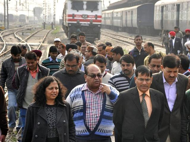 Ambala division railway manager Dinesh Kumar (centre) along with other officials during his visit to the railway station in Chandigarh on Saturday.