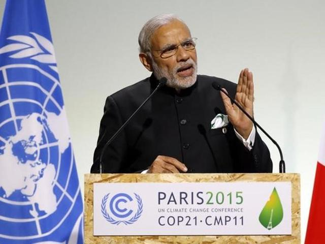 India's Prime Minister Narendra Modi addresses world leaders at the COP21, United Nations Climate Change Conference, in Le Bourget, outside Paris, Monday, Nov. 30, 2015.  On Sunday, December 13, PM Modi hailed the climate change deal adopted in Paris as the victory of 'climate justice'.