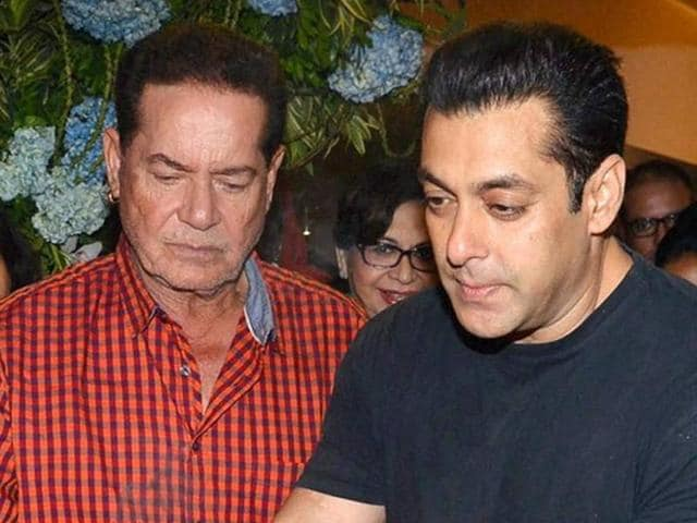 Screenwriter Salim Khan along with his son Salman Khan and wife Helen participates in a procession for the immersion of an idol of Lord Ganesh in a file photo from September 18, 2015.