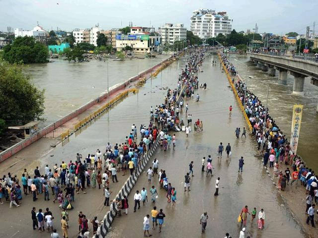 File photo of people travelling on a boat as they move to safer places through a flooded road in Chennai.
