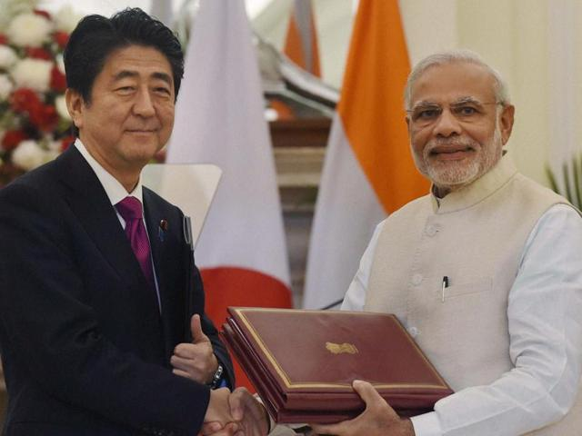 Prime Minister Narendra Modi and his Japanese counterpart Shinzo Abe exchange documents after signing an agreement at Hyderabad House in New Delhi on Saturday(PTI)