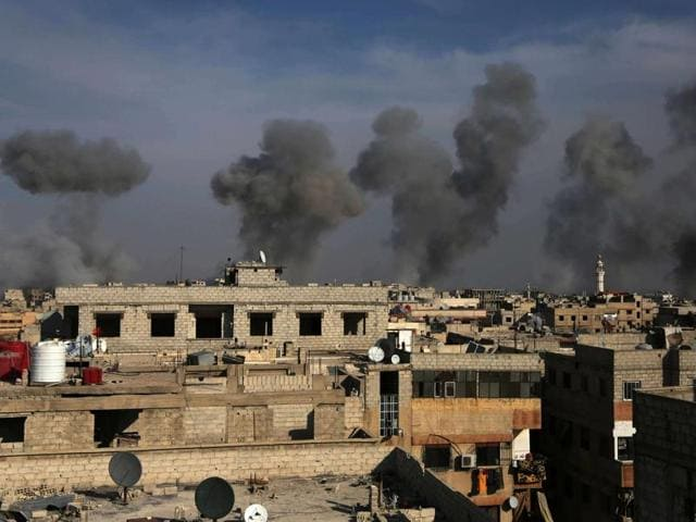 Smoke billows after air strikes by regime forces on the town of Douma in the eastern Ghouta region, a rebel stronghold east of the capital Damascus on Sunday.