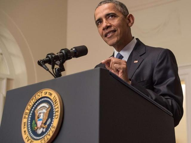 US President Barack Obama delivers a statement in the Cabinet Room at the White House in Washington DC on Saturday after an international climate accord was reached in Paris. Obama hailed as historic the climate agreement calling it