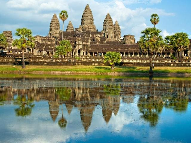 Archaeologists who discovered buried 'towers' and remains of a huge structure near Angkor Wat, the world's largest religious monument.
