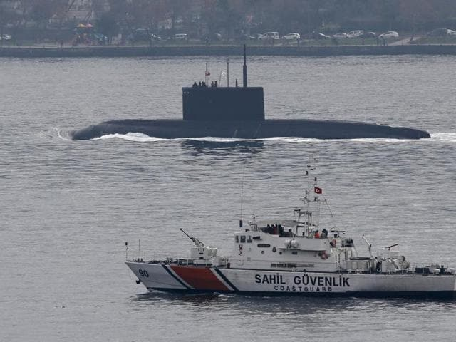 "Russia's diesel-electric submarine Rostov-on-Don is escorted by a Turkish Navy Coast Guard boat as it sets sail in the Bosphorus. The Russian defence ministry has announced that a destroyer opened fire on a Turkish fishing boat to ""avoid a collision"""