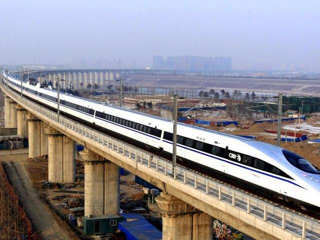 A bullet train passes over Yongdinghe Bridge in Beijing. China has kept its offer to construct a bullet-train corridor from Delhi to Chennai open after India signed a multibillion dollar deal for the bullet train route between Mumbai and Ahmedabad with Japan.(AP File Photo)