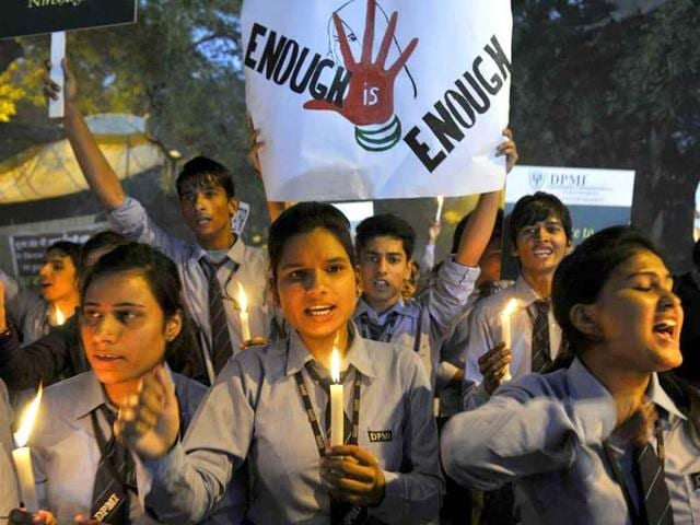 Students protest against the gang-rape of a 23-year-old woman on a moving bus on December 16, 2012, in New Delhi.