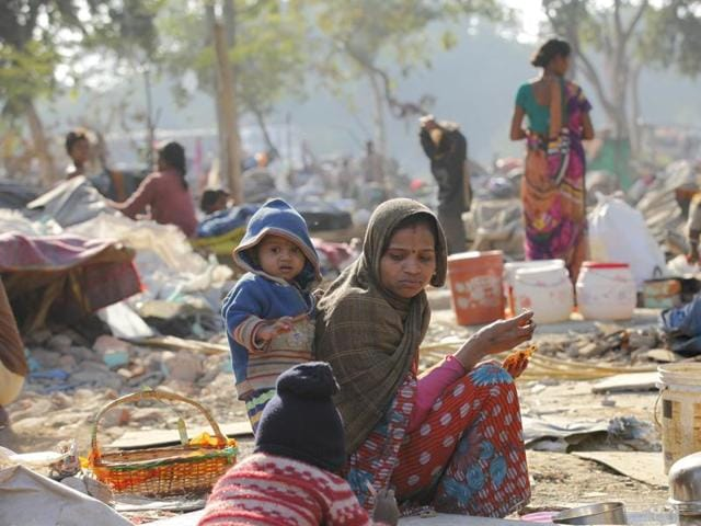A woman sits near her demolished shanty at Shakur Basti. Delhi Police registered a case of death due to negligence in connection with the loss of life of an infant allegedly during the demolition drive in the slum cluster.