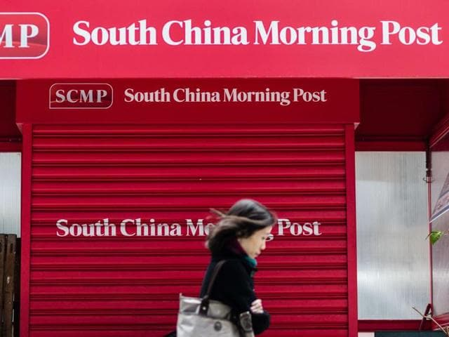 Copies of the South China Morning Post (SCMP) newspaper are seen on a newspaper stand in Hong Kong, China. Alibaba has agreed on a $265.8 million deal to acquire the South China Morning Post and other media assets of SCMP Group.