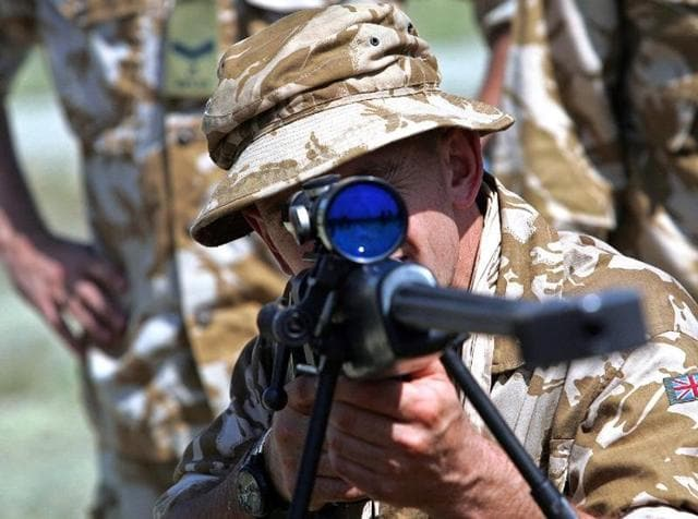 A British soldier of the 7th Battalion rifle regiment look through the scope of a Black Arrow sniper rifle at the Krivolak army training center, 100 km from capitol, Skopje. (Representational Image (AFP))