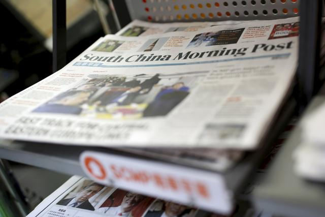 File photo of South China Morning Post (SCMP) newspaper that Alibaba agreed to buy out last week. Shares in the owner of Hong Kong-based newspaper Ming Pao surged on Thursday after rumours of Alibaba buying out the newspaper.