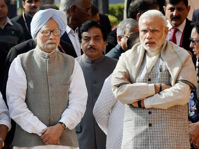 Prime Minister Narendra Modi with former PM Manmohan Singh while paying tribute to the martyrs of 2001 Parliament attack on its 14th anniversary at Parliament House in New Delhi on Sunday. The government's plan to call the Congress for a meeting comes after the Opposition party's charge that the Centre had not responded to three of its key demands on the long-pending bill.