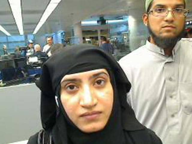 This image, obtained from US Customs and Border Protection, shows Syed Farook and Tashfeen Malik, as they were going through customs in Chicago's O'Hare International Airport.