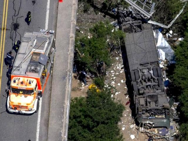 Aerial view of the overturned bus which crashed in Argentina's northern province of Salta, killing 43 patrol officers while 8 were being treated for injuries.
