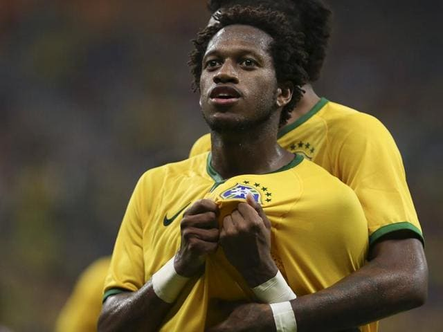 Brazilian midfielder Fred celebrates after scoring against Dominican Republic during their friendly match in Manaus on October 9, 2015.