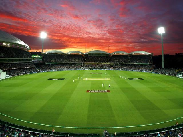 New Zealand's Tim Southee bowls as the sun sets during the first day of the third cricket test match against Australia at the Adelaide Oval on November 27, 2015.