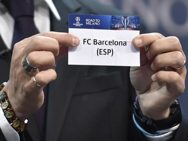 UEFA Champions League final ambassador Javier Zanetti shows the name of FC Barcelona football club during the draw for the UEFA Champions league round of sixteen, on December 14, 2015.