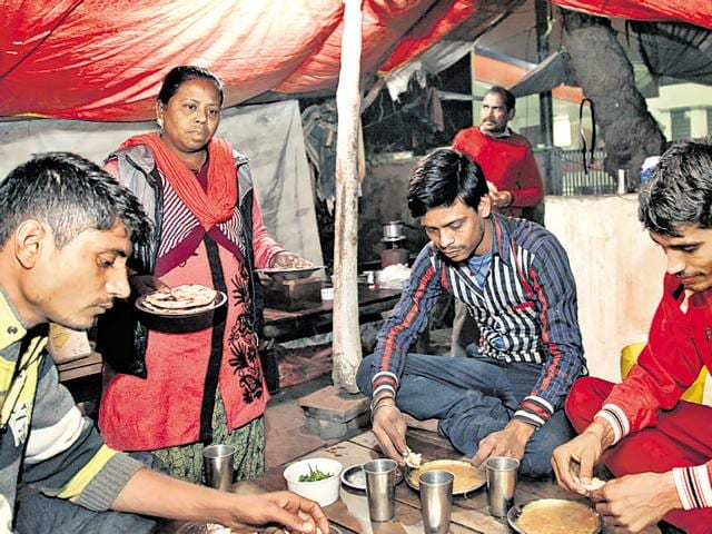 Rajni, a resident of Haiderpur, runs a dhaba on her own at New Delhi's Rohini after her husband's demise last year. Rajni works till late at the dhaba to feed a family  of seven.